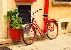 Red bicycle by Juicy Photography on @creativemarket