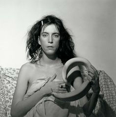"""Patti Smith"", 1978, by Robert Mapplethorpe. Patti Smith sits for her portrait in a bed sheet. More images here: http://www.dazeddigital.com/fashion/article/19356/1/mapplethorpe-me"