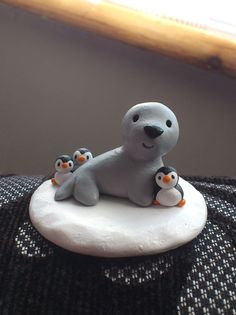 Mini pottery grey seal, with some very tiny penguins! from byKateElford