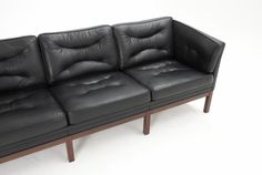 Danish black leather 3 seater sofa with wooden base | From a unique collection of antique and modern sofas at http://www.1stdibs.com/furniture/seating/sofas/