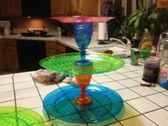Want a luau party cake tower 2 cups and 3 plates and a hot glue gun  cake on top cupcakes on bottom  A cheap tower  Get all at dollar tree so cheap