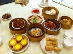 """Dim Sum- Hong Kong cuisine: Yum cha (Chinese: 飲茶) is a Cantonese style morning or afternoon tea, which involves drinking Chinese tea and eating dim sum dishes. Yum cha in Cantonese Chinese literally means """"drink tea"""". Dim sum (點心) refers to the wide range of small dishes, whereas yum cha, or """"drinking tea"""", refers to the entire meal."""