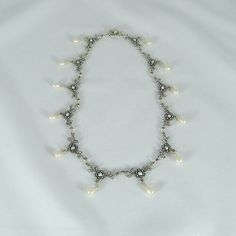 Pearl Teardrops and Crystals Metal Floral Necklace by tbyrddesigns, $39.00