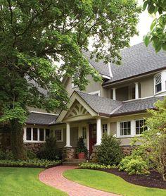 pleasing exterior, house and door colors, winding brick sidewalk, landscaping