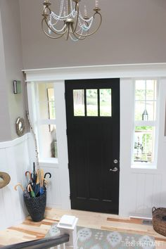 I don't like a black front door but I LOVE LOVE LOVE all the molding around it and the side windows, fabulous!!!