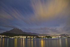 Beautiful Lucerne(Luzern) Switzerland Night Scene with Mount Pilatus and Lake Lucerne and the moving clouds flying over the city lights below. Moving Clouds, Lucerne Switzerland, City Lights, Scene, Night, Beach, Water, Photography, Travel