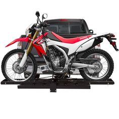 """The Black Widow tow hitch motorcycle carrier fits 2"""" trailer hitches, and includes a loading ramp which stores conveniently on the rack. 500lb Capacity."""