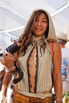 Photo taken at the Burning Man 2010 festival (Black Rock Desert, Nevada).  asian woman, camera, center camp, fashion, people, photographer.