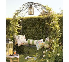 So romantic and peaceful looking. I wish I had a garden hedge like that along with the beautiful trellis. Stunning.