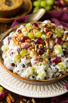 A simple fruit salad made with red and green grapes that's covered with a rich creamy dressing and pecans. A summertime favorite!