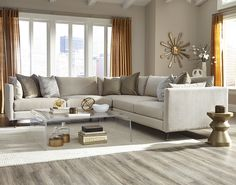Jonathan Louis' Pia Collection is the epitome of neutral chic. Pair this functional sectional with grays and golds for a subdued yet oh-so-stylish statement.