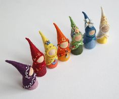 Tiny peg dolls wearing delicately embroidered felt clothes, uniquely designed according to the astrological symbology of the days (followed by Waldorf traditions as well). With the gnomes you can celebrate every day for its unique qualities and embrace the very same qualities in