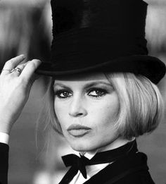 Brigitte Bardot having a menswear-inspired moment, top hat and all.