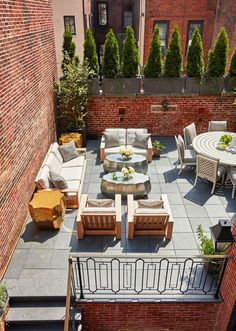 A spacious first-floor terrace with plenty of seating for entertaining | archdigest.com