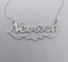 NEVAEH Name Poster featuring photos of actual sign letters