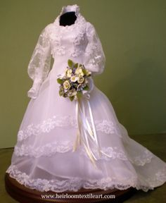 Miniature of 1980's style gown and bridal bouquet.  Stands just under 11 inches tall.