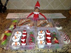 Elfie made the kids lunch and snack for school.  Jam sandwich Rudolfs, donut snowmen, complete with carrot noses, strawberry Santas, red and green apple slices, red and green gummies, and a Little Debbie Christmas cake.