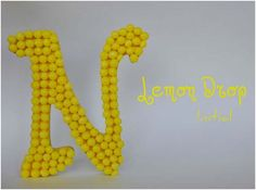 DIY: Lemon Head Initial ~ You know I am thinking of every kind of kaleidoscope candy that I love (: Who needs a gigantic candy letter in their house?!?