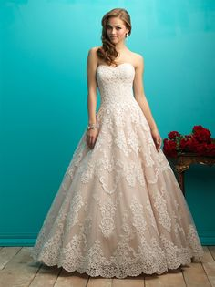 STYLE: 9268  High-contrast lace patterning adds subtle texture to our strapless ballgown.  Colors: White, Ivory, Champagne/Ivory Fabric: Lace Size: 2 - 32