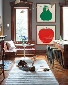 i love these windows, the fruit prints, and that divine leather sofa.