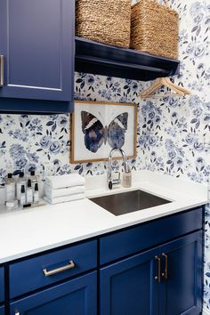 brighton keller laundry room blue and white print wall paper navy blue painted cabinets cute laundry room Blue Laundry Rooms, Laundry Room Cabinets, Blue Cabinets, Laundry Room Storage, Laundry Room Design, Mud Rooms, Laundry Nook, Laundry Drying, Laundry Closet