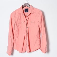 American Eagle coral corduroy button down Excellent used condition. With snaps! A very soft, 100% cotton, super flattering fit, shirt. American Eagle Outfitters Tops Button Down Shirts