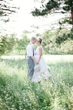 Bride + groom shots in a field // photo by Athena Pelton - the suspenders are so cool!