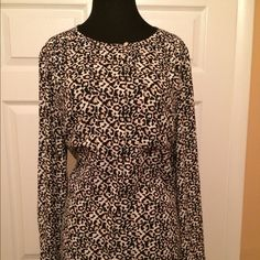 LOFT Pre-Loved Animal Print Blouse LOFT Black and White Animal Print Blouse with hints of pink. Two front pockets as shown.  Button front halfway.  Very Stylish and Chic.  This blouse will compliment any skirt or pant suit. Size: Large/12 Material:  100% Polyester. WORN ONCE!!!' LOFT Tops Blouses