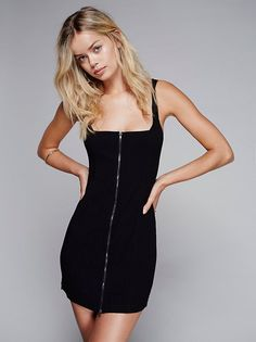 Top Down Bodycon Slip | Ultra stretchy bodycon slip dress with front exposed zipper closure. Crisscross back adds a skin baring detail to this simple look.