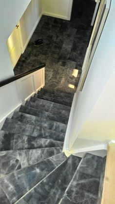 Tundra Grey staircase and entre Floor . All made in Leather tiles