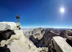 Hiking the John Muir Trail | Atop Mount Whitney. Photo by Travis Burke