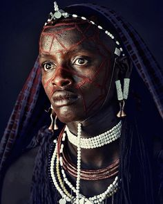 The #Maasai tribe measures wealth by the number of cattle and children a person has. Men can have as many wives as they can afford and support. Each wife is responsible for building her own home for herself and her children. A hierarchy exists among the wives, with the first wife holding the most value and power. #Tanzania