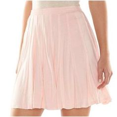 "LC LAUREN CONRAD Pink Skater Skirt {HP}{5⭐️Rated} NWT LC Lauren Conrad pink lined pieced skater skirt will be a flirty addition to your wardrobe! FEATURES: Lined, pieced design, soft jersey construction, elastic waistband, rayon, hand wash.  *L (12-14)/Waist 33"" *Bundle Discounts, Smoke-Free, No Trades LC Lauren Conrad Skirts Circle & Skater"