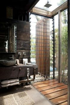 Rustic bathroom with glass shower and a view