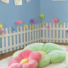 an adorable idea for a reading corner with a garden theme