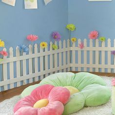 Similar to what we're doing for Elise's big girl room. White picket fence and satin flowers peeking through.