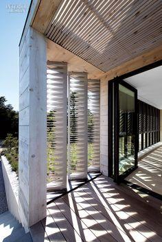 Bates Masi Brings Sophistication to Amagansett Beach House | Decking outside the entry is mahogany. #design #projects #interiordesign interiordesignmagazine
