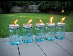 FOR BACKYARD FUN, NO BUGS! All you need is a package of Mason jars, some cotton string and some liquid citronella (find it in big jugs at any home-improvement store and even some grocery stores). Use a hammer and nail to poke a hole in the top of the lid, then pour in the citronella, put the top on and drop in the wick. Allow the string about 10 minutes to soak up some oil. Cute decoration on picnic table too!
