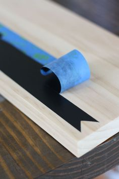 Cheese board or serving tray with just a strip of chalk board paint