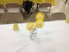 Arie's baby shower decor. Made with a foam ball, q-tips, & yellow food coloring and then placed on a flower stem