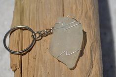 Genuine frosted sea glass keychain. Genuine hand wire wrapped frosted sea glass and silver chain key ring for keys. The sea glass is genuine
