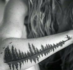 "Cool idea for a sound wave tattoo: turn it into a lake w/ trees. This one's a father saying ""Babydoll"""