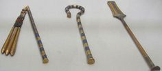 The Heqa staff, Sekhem Scepter and Flail of Tutankhamun copyright A Parrot