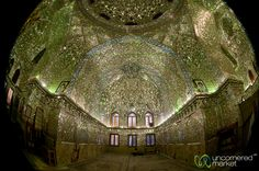 A spherical panorama from inside the outrageously mirrored and decorated Shāh Chérāgh Mosque in Shiraz, Iran. Like a disco ball turned inside out.