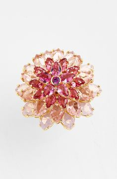 Wearing this sparkly pink cocktail ring to the next dinner party.