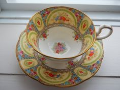 Aynsley Teacup: yellow blue and red.
