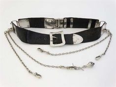 A Victorian house keepers black leather chatelaine belt with hallmarked silver buckle and mounts and sections for hanging chatelaine attachments. Extensively hallmarked London 1876 maker Wright & Davies and marked ' Thornhill 144 Bond Street London ' . ( with 4 associated silver plate chatelaine chains )
