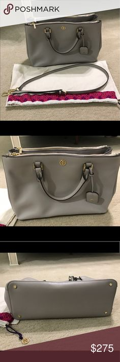 "Tory Burch Robinson Double Zip Tote In extremely great condition maybe used a handful of times. Saffiano leather. Gold Logo hardware detail. Double zip top closure. Snaps on each side to adjust size. Over-sized zipper compartments on front and back wall. Interior zip pocket and two additional open pockets. 24"" adjustable and removable cross-body strap. Top handles with 4""drop. Height: 10"" (25 cm) Length: 14"" (35.5 cm) Depth: 5.5"" (14 cm) Tory Burch Bags Totes"