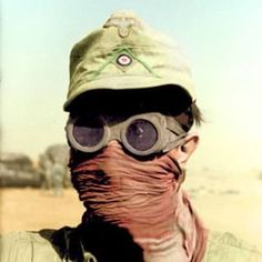 A German trooper of the Afrika Korps protects his eyes and face from the harsh sandstorms of the desert. The Afrika Korps was an expeditionary force of the Wehrmacht sent into Allied-controlled Northern Africa to dispatch the enemy forces stationed in the highly strategic and sought after region, rich with oil and geographically an excellent launching point for Allied forces into Axis-dominated Southern Europe.