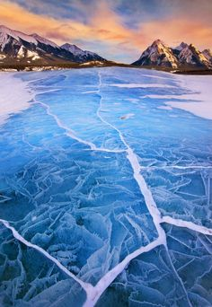 By Long Nguyen: This image is taken at lake Abraham in Alberta, Canada. The remote lake becomes really phenomenal with beautiful ice formations in winter. This is one of the most challenging trips I've ever had so far. The weather was very cold at minus 7 F degree and strong wind. I spent three days at the lake and good light only happened about 10 minutes on the last day of the shoot.